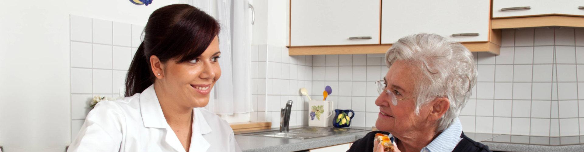 caregiver assisting senior woman to eat